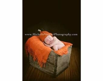Orange hand knit pumpkin hat with leaf