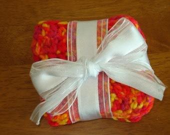 Set of six colorful orange/yellow/red crochet coasters