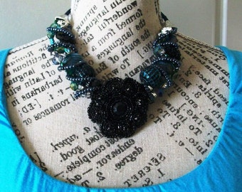 SALE Statement Necklace and hair pins Black and Dark Blues with a vintage brooch focal and coordinating beads wirewrapped