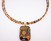Orange and black seed bead necklace glass pendant necklace