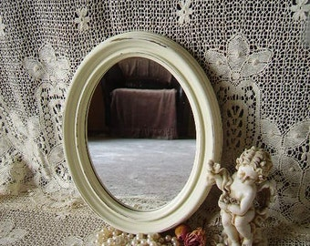 Shabby white small oval  wall mirror, painted vintage