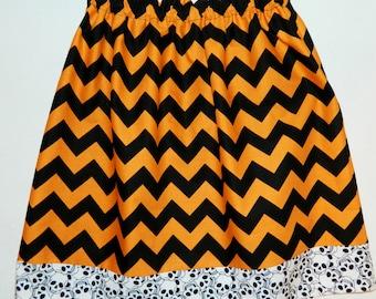 Girl, baby, toddler, tween Halloween holiday skulls border with orange black chevron skirt NB 3m 6m 12m 18m 24m 2T 3T 4T 5T 6 7 8 10 12 14