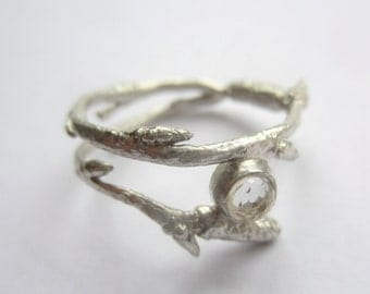Handmade silver twig ring with white Topaz