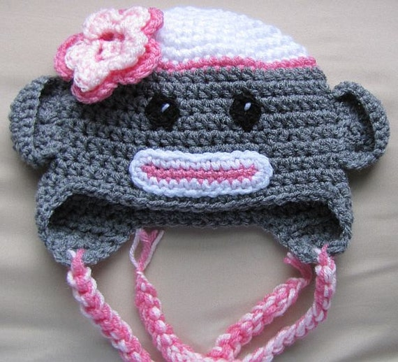 Pink trimmed sock monkey hat for small child 2-3