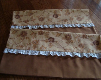 Pair of Decorative king size pillow cases in shades of brown stems with flowers