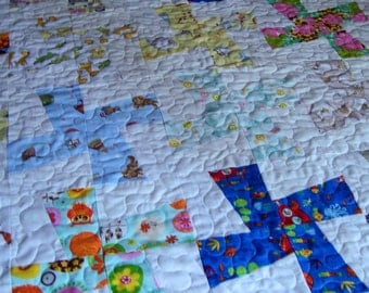 Infant windmill quilt done in baby prints