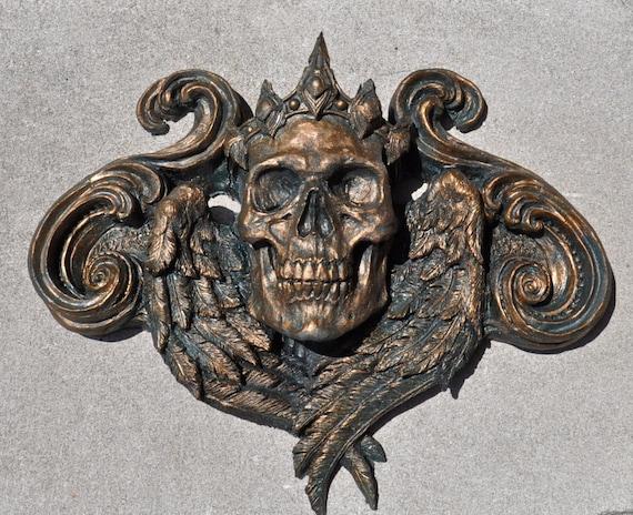 https://www.etsy.com/listing/75162116/queen-calavera-wall-plaque-bronze-finish?ref=shop_home_active_21