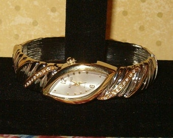Kessaris Watch, Japan Movement Quartz Watch Bracelet in Silver Tone Metal w Clear Rhinestone Bridge Rows in Golden