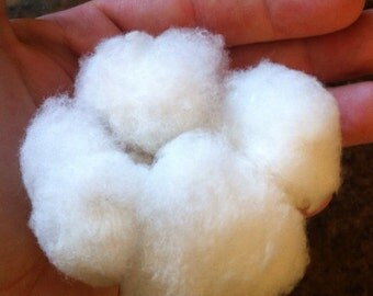 Freshly picked organic natural seed cotton for spinning