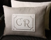 Decorative pillow cover with appliqué initials sign