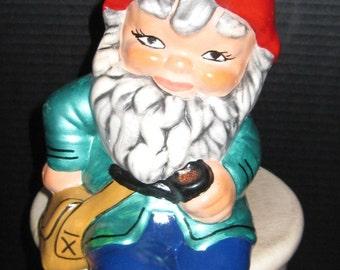 Sitting Gnome enjoying his pipe.