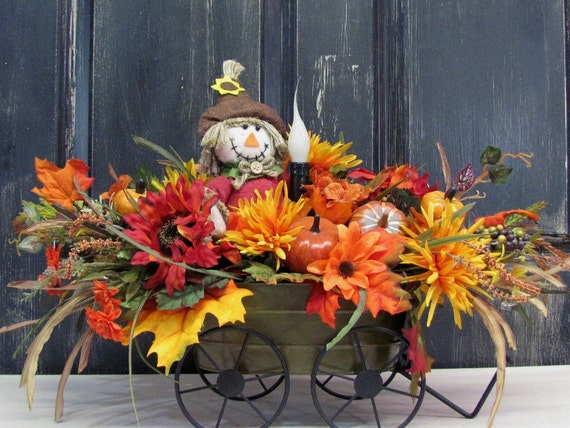 Fall floral centerpiece scarecrow floral wagon by for Scarecrow home decorations co ltd