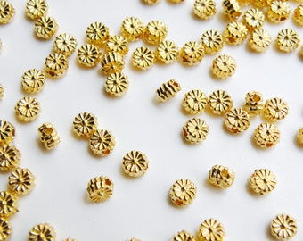 50 Adorable little flower bead spacers shiny gold plated 4x2.5mm 1531BB