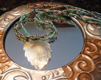 Shell Leaf Pendant on Triple Strand Necklace