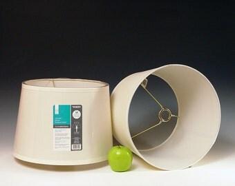Translucent fabric hardback drum shade for High Desert Dreams lamps.