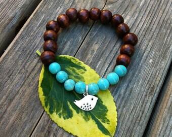Yogi inspired wood bead bracelet with sweet bird and turquoise howlite beads