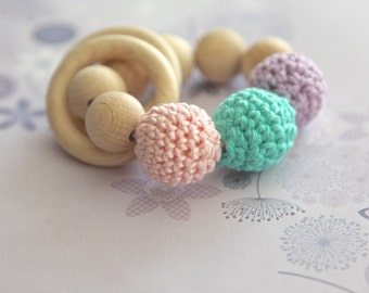 Teething toy with crochet wooden beads and 2 wooden rings. Lavender, rosa, green mint wooden beads rattle.