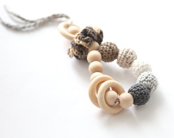 Teething toy rattle with crochet wooden beads and 3 wooden rings. Natural beige, white and grey