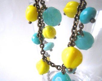 Glass bead necklace in caribbean blue and yellow