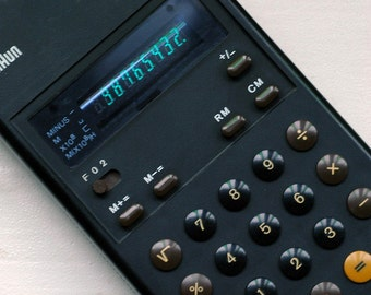A vintage Braun ET 22 Control Pocket Calculator designed by Dieter Rams and Dietrich Lubs, 1976