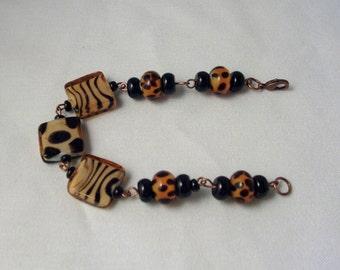 Limited Edition ~Animal print Zebra & Sheetah square links, black onyx and copper Bracelet