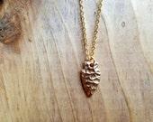 tiny brass arrowhead necklace