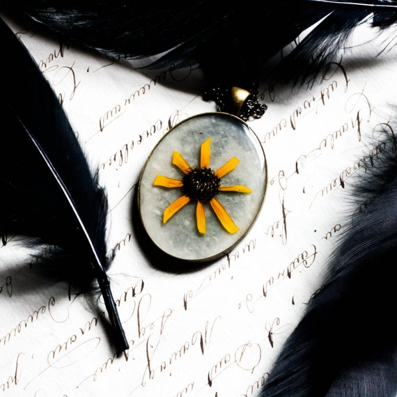 handmade pressed flower necklace in resin natural botanical wildflower black eyed susan golden sunshine yellow spring summer garden pendant