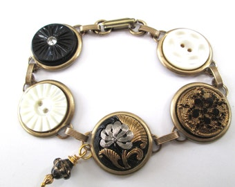 Antique button bracelet. Black and golds. Carved mother of pearl shell buttons, glass buttons.