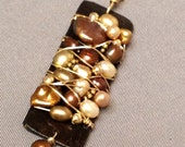 Hand Cut Chocolate Brown Patina Brass Pendant with Freshwater Pearls laced with Gold Filled Wire on a gold chain