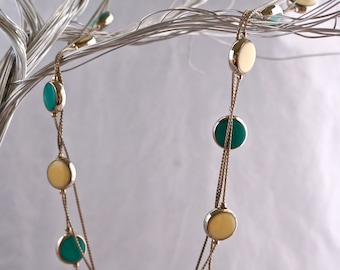 Vintage teal and bone colored necklace with silver chain