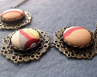 Beige, coral and grey fabric and metal three part necklace