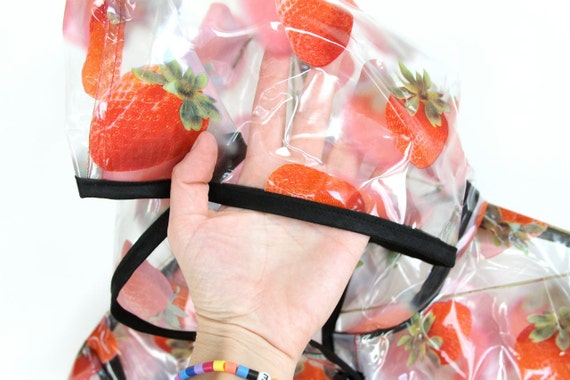 plastic p o p, STRAWBERRIES see through hooded raincoat . napkin