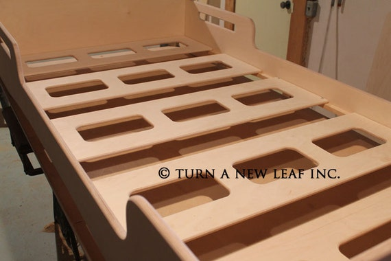 Natural Twin sized Montessori style Infants bed.