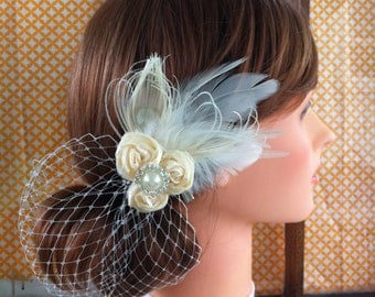 Rosette Ivory bridal hair brooch clip, with birdcage netting veil attached. Katy's clips