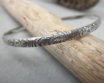 Oxidized flower pattern sterling silver bangle bracelet