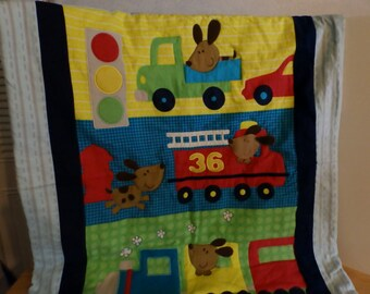 Baby boy quilt truck, fire truck and train in red, yellow and green