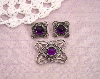 "1992 Avon ""Bold and Classic"" brooch and pierced earring set silver tone with royal purple cabochon"