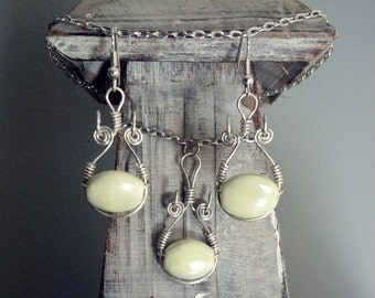 Curious bead and wire-wrapped earring and necklace set