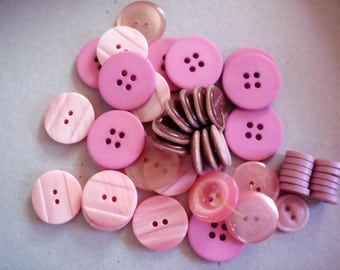Lot of more than forty-five mixed size/style pink plastic buttons