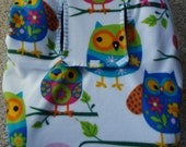 Reversible Baby Car Seat Cover has a colorful owl print on one side and solid bright blue on other side. - CreationsForKids