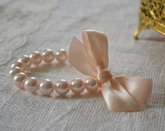 Ella - Pearl Bracelets with Satin Ribbon Bows - Baby Pink pearls, blush / nude ribbon - Bridesmaids & Flower Girls