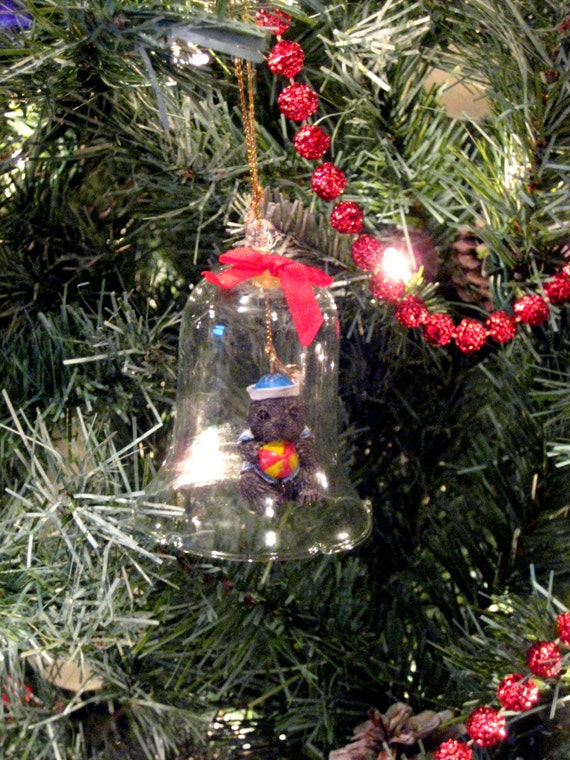 Animal Collect A Bell Holiday Ornament, porcelain bisque Otter with a ball in a glass bell