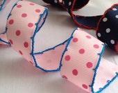Polka dot grosgrain ribbon with crochet edge. Navy and pink