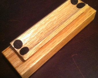 Oak pen stand with 2-Tier design.  Pen is cradled and padded with felt.