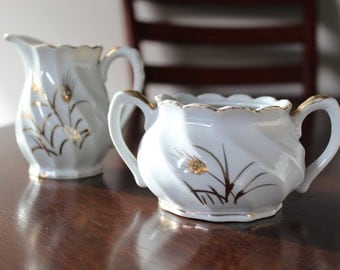 Lefton sugar bowl and creamer Gold Wheat pattern,white