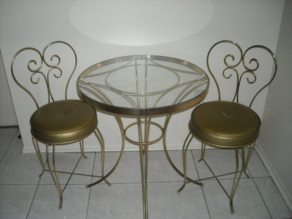 Unavailable listing on etsy for Mid century bistro table