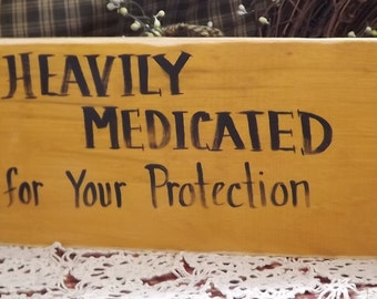 """Funny Primitive wood sign """"Heavily medicated...for your protection"""