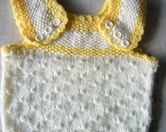 Baby handknitted vest without sleeves and with buttons in white and yellow