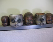 Creepy  zombie baby Doll Head Planters or Decorations