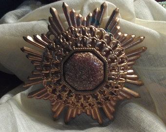 1930's Stamped Copper and Goldstone pendant.